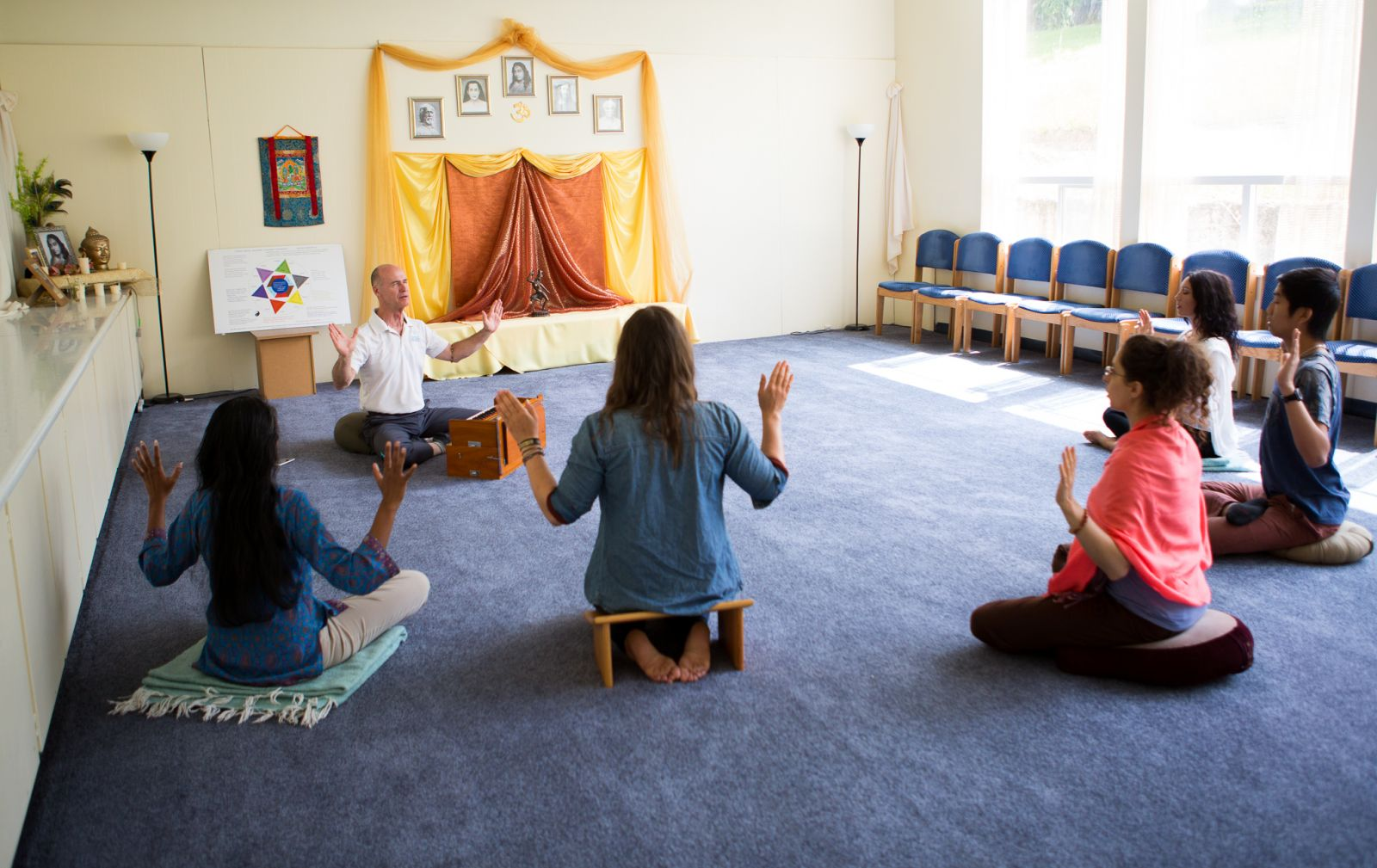 Frredom from Pain meditation class Aumkara leading sharing AUM chanting with Hands upraised