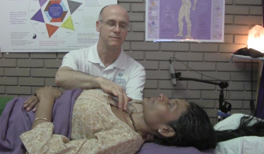 Jin Shin Jyutsu applied to back of neck and under collar bone by Aumkara Newhouse on Supriya Shanbhag